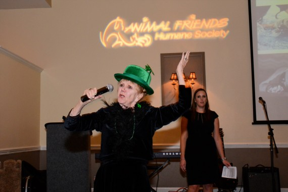 Maggie calling for bids at the 2014 Humane Society Charity Auction.